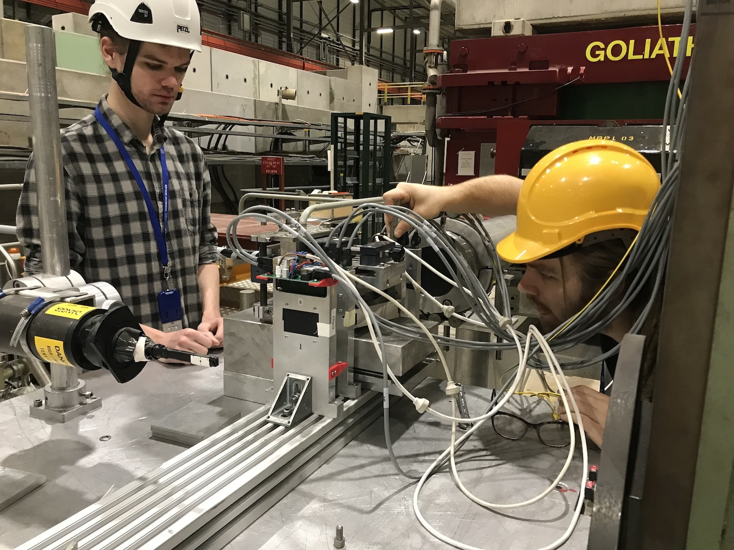 Two members of the NA63 collaboration adjust part of the set-up used by the team to measure the phenomenon of radiation reaction.