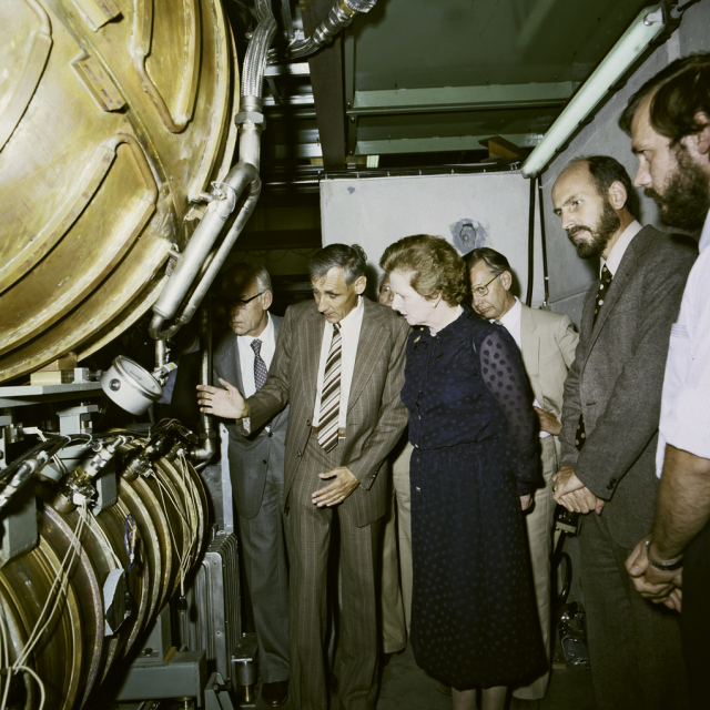 On a 1982 visit to CERN, Margaret Thatcher is shown a cavity from the Large Electron Positron Collider - see a similar one in our exhibition. (Image: CERN)
