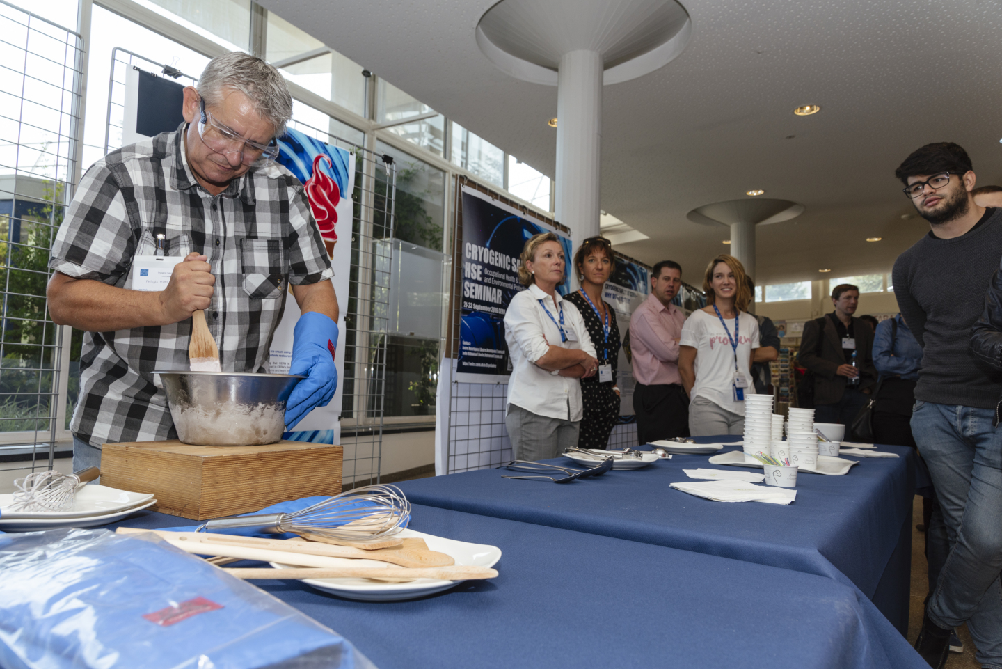 Philippe Moret prepares ice cream with liquid nitrogen as HSE personnel discuss cryogenic safety with visitors to the stand. (Image: M.Brice/CERN)