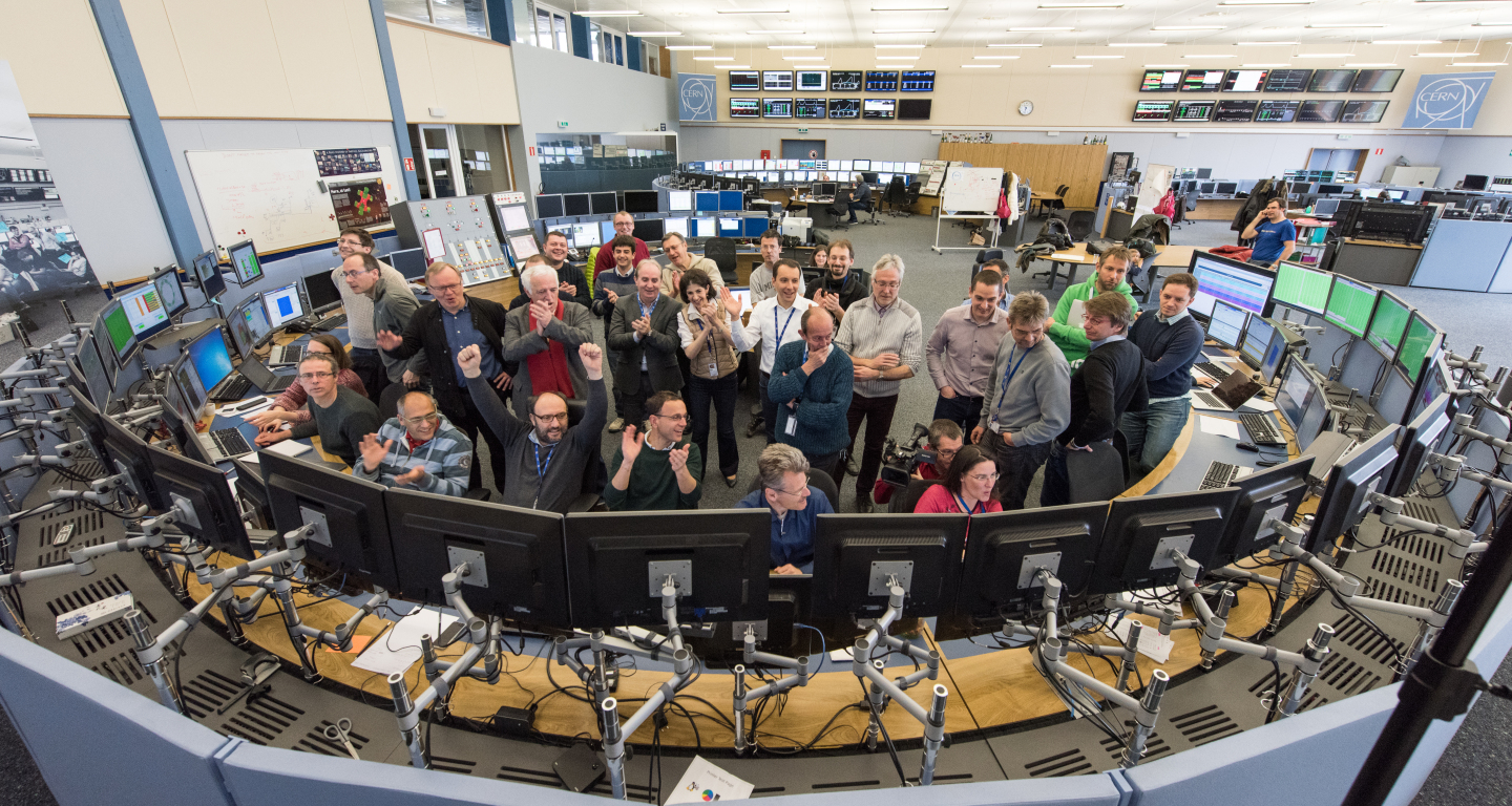 CERN Management and LHC operators applaud as the first  beam circulates in the LHC, on Friday 25 March